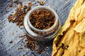 Smoking pipe with tobacco leaves Royalty Free Stock Photo