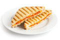 Classic tomato and cheese toasted sandwich on white plate Royalty Free Stock Photo