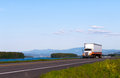 Classic truck on the road with beautiful landscape white an orange stripe local scenery composed of rivers islands green trees Royalty Free Stock Image