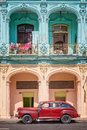 Classic vintage car and coloful colonial buildings in Old Havana Royalty Free Stock Photo