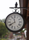 Classic vintage clock at old railway station Royalty Free Stock Photo