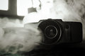 Classic vintage old 8mm movie camera on table with fog close up. Selective focus. Old Soviet Camera Royalty Free Stock Photo
