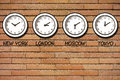 Classic wall bricks clocks clock timezone on of Stock Photo