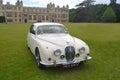 Classic white jaguar motorcar saffron walden essex england june on show at audley end house Stock Photo