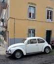 Classic white volkswagen beetle motorcar lisbon portugal march in the streets of the estrela district of lisbon portugal Royalty Free Stock Photography