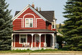 Classic wooden home with porch a vintage clapboards and Royalty Free Stock Image