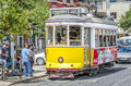 Classic yellow tram of lisbon portugal july traditional trams downtown on july trams are used by everyone and also keep the Stock Photography