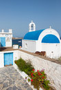 Classical greek church with the blue dome on background of sea on island Royalty Free Stock Photo