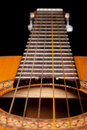 Classical guitar close up on dark Royalty Free Stock Photography