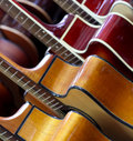 Classical guitars image of several lined up in a row Stock Images