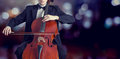 Classical music cellist playing on cello on bokeh background Stock Photos