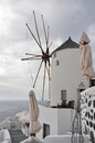 Classical old windmill on greek island santorini a Stock Photo