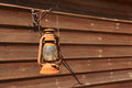 Classical rusty oil lamp hanged on a wooden wall Stock Photography