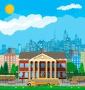 Classical school building and cityscape. Royalty Free Stock Photo