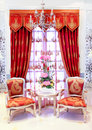 Classical stylish armchairs before window Royalty Free Stock Photo