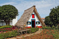 Classical triangular small house on island Madiera Royalty Free Stock Images