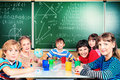 Classmates group of school children studying in classroom Stock Image