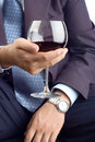 Classy businessman with a drink Stock Photography