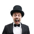 Classy gentleman vintage with bowler hat and bow tie screaming at camera Royalty Free Stock Photo