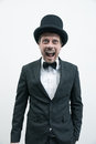 Classy gentleman vintage with bowler hat and bow tie screaming at camera Stock Image