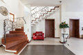 Classy house corridor with elegant stairs and armchair Royalty Free Stock Photo