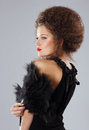 Classy woman with frizzy hairs in evening dress fashionable glamorous brunette Royalty Free Stock Photography