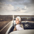 Classy woman in a vintage car Stock Images
