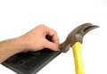 Claw hammer missing nail and hitting man s thumb yellow steel head tiny Royalty Free Stock Photography