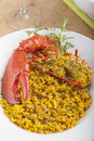 Clawed lobster with yellow rice plate of Royalty Free Stock Photography
