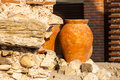 Clay amphora standing in the garden terracotta a stone wall background Stock Images