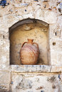 Clay ampohora pot on a stone wall Royalty Free Stock Photo