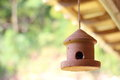 Clay birdhouse handcrafted with a blur background Royalty Free Stock Photo
