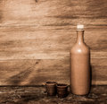 Clay bottle and clay cups retro bootles with on the wooden board background Royalty Free Stock Photography