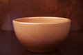 Clay bowl on a wooden background Stock Photos