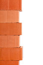 Clay brick border stacked new bricks isolated on white background Stock Images