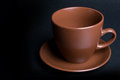 Clay (ceramic) cup on dark Royalty Free Stock Photos