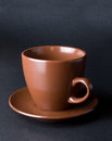 Clay (ceramic) cup on dark Royalty Free Stock Photo