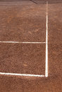 Clay cort tennis game white lines corners contrasting to orange Royalty Free Stock Photo