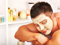 Clay facial mask in beauty spa man with Royalty Free Stock Images