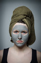 Clay facial mask the portrait of young woman Royalty Free Stock Images