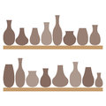 Clay jugs and vases on the shelves. Pottery. Royalty Free Stock Photo