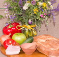 Clay pot, apple,meat pork and flowers Royalty Free Stock Photo