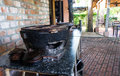 Clay pot with charcoal for cooking. Traditional Vietnam. kitchen. house. Royalty Free Stock Photo