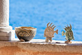 Clay pot and fishes stand on wall Stock Images