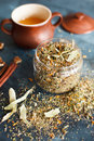 Clay pot with honey, cinnamon sticks, nuts and a herb collection Royalty Free Stock Photo