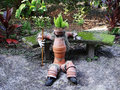 Clay pot man in garden a made from recycled pots sitting a Royalty Free Stock Image