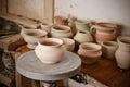 Clay pot on a potter`s wheel Royalty Free Stock Photo
