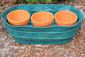 Clay pots in metal container a row of fit inside a for garden yard and landscape decoration Royalty Free Stock Image