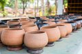 Clay pots raws of for sell standing outside Stock Photography