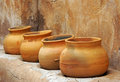 Clay pots on the shelf Royalty Free Stock Photos